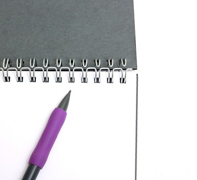 writing a business plan notepad and pen